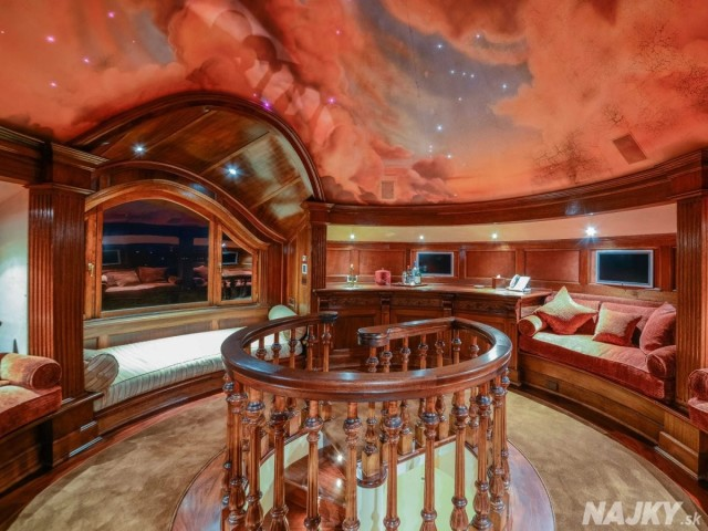 at-the-very-top-of-the-house-is-this-round-reading-room-with-a-painted-ceiling