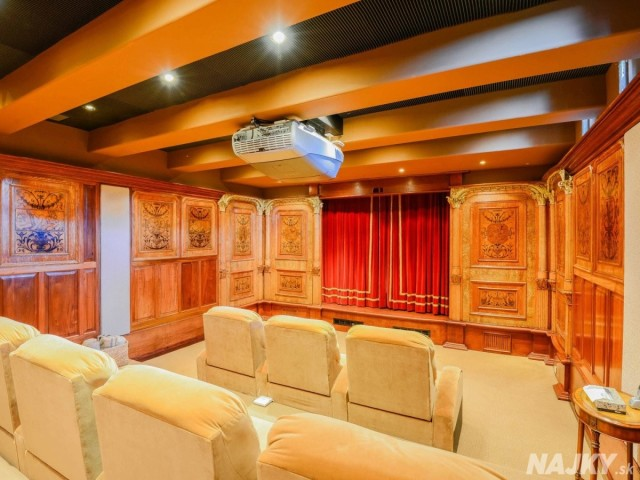 downstairs-is-a-custom-built-movie-theater-with-seating-for-seven-and-a-projector