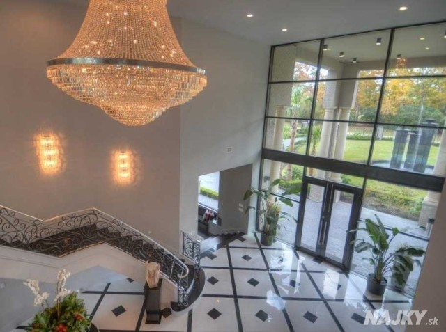 guests-are-immediately-greeted-by-a-towering-entryway-complete-with-a-swarovski-crystal-chandelier