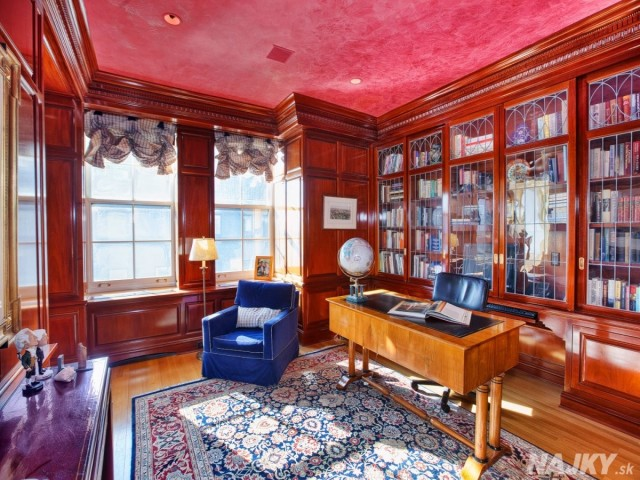 the-library-still-retains-the-classic-old-world-feel-with-custom-wood-cabinetry-and-a-venetian-plaster-ceiling