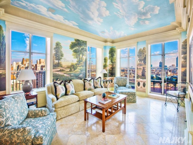 the-most-interesting-room-by-far-is-this-sun-room-it-features-a-full-mural-on-the-walls-and-ceilings-with-access-to-the-terrace