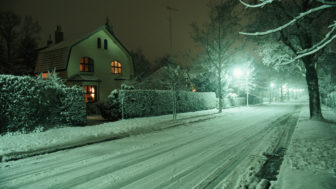 Snow covered street, night