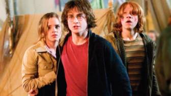 """This photo provided by Warner Bros Entertainment shows actors Daniel Radcliffe as Harry Potter, center, Emma Watson as Hermione Granger, left, and Rupert Grint as Ron Weasley in a scene from """"Harry Potter and the Goblet of Fire."""" The fourth film in the popular children's series has rung up the franchise's best-ever first-day DVD sales, 5 million copies the distributor said Thursday, March 9, 2006. The DVDs hit the market Tuesday. (AP Photo/Warner Bros., Entertainment)"""