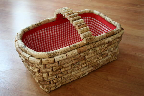 http://www.chicaandjo.com/2008/08/05/recycle-wine-corks-to-give-a-plain-basket-new-life/
