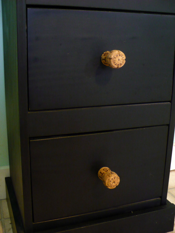 http://dollarstorecrafts.com/2011/03/make-recycled-champagne-cork-drawer-knobs/