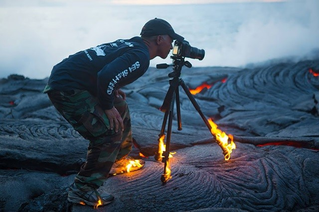 http://www.boredpanda.com/photographer-kawika-singson-catches-fire-while-shooting-lava/
