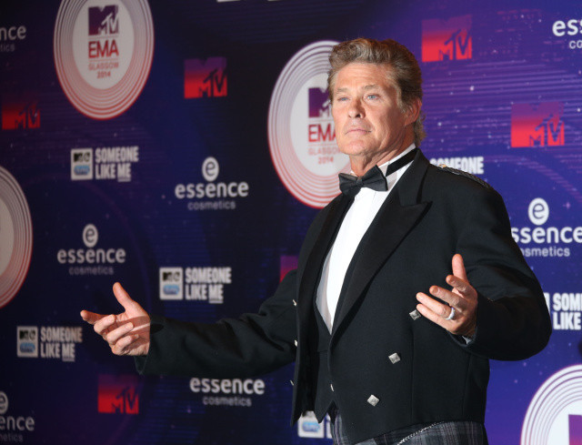 Actor David Hasselhoff poses for photographers upon arrival at the 2014 MTV European Music Awards in Glasgow, Sunday, Nov. 9, 2014. (Photo by Joel Ryan/Invision/AP)