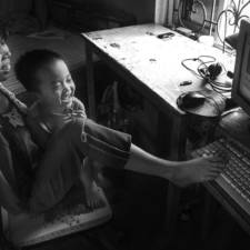 After the war vietnamese girl born without arms lives normal life and takes care of her nephew 4__880.jpg