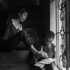 After the war vietnamese girl born without arms lives normal life and takes care of her nephew 8__880.jpg