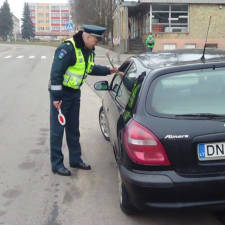 Lithuanian police officers give flowers international womens day 1.jpg