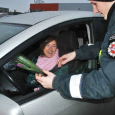 Lithuanian police officers give flowers international womens day 10.jpg