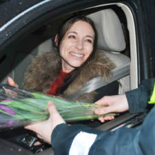 Lithuanian police officers give flowers international womens day 14.jpg