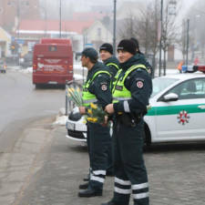 Lithuanian police officers give flowers international womens day 151.jpg