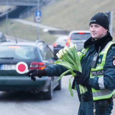 Lithuanian police officers give flowers international womens day 16.jpg