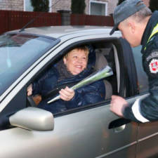 Lithuanian police officers give flowers international womens day 9.jpg