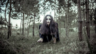 Girl with scary makeup in the forest