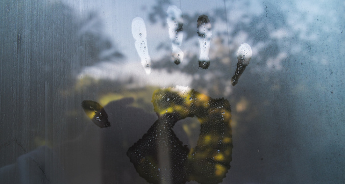 Hand print on hazy glass in the morning