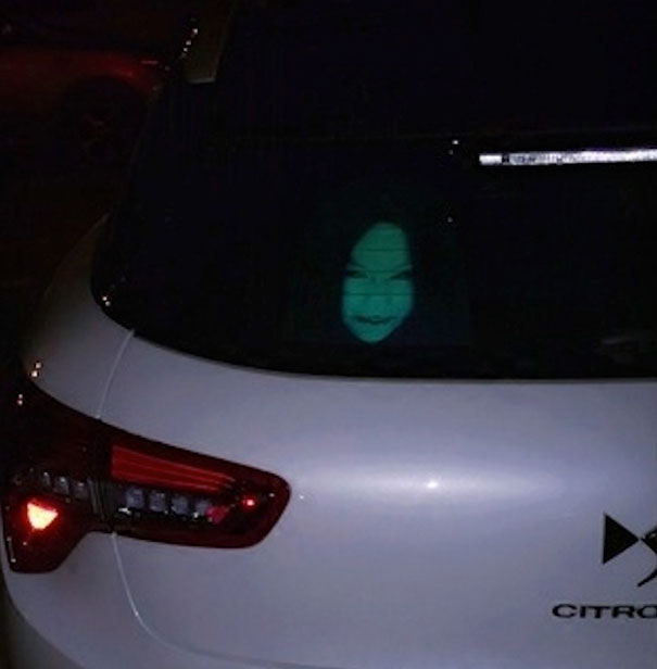 http://dangerousminds.net/comments/drivers_using_reflective_face_decals_to_discourage_high-beam_users