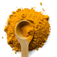 Turmeric powder and Wooden Measuring Spoon