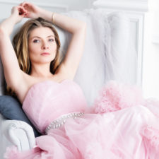 Dreamy blond hair woman in a light pink gown