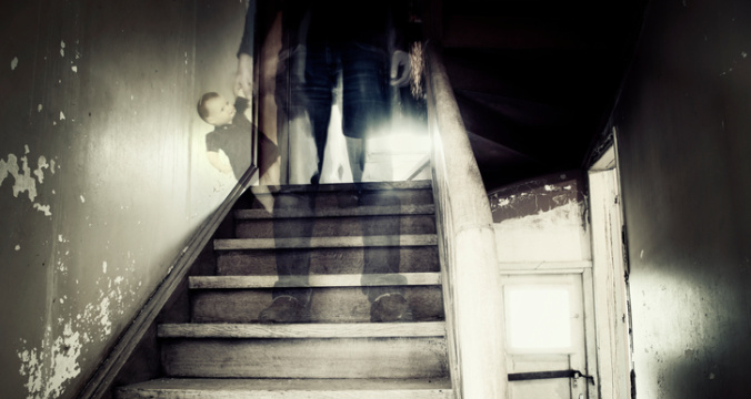 Ghostly figure in a hounted house