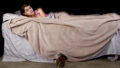 Young Woman Sleeping With a Monster Under The Bed