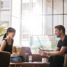 Smiling business partners working together in modern office