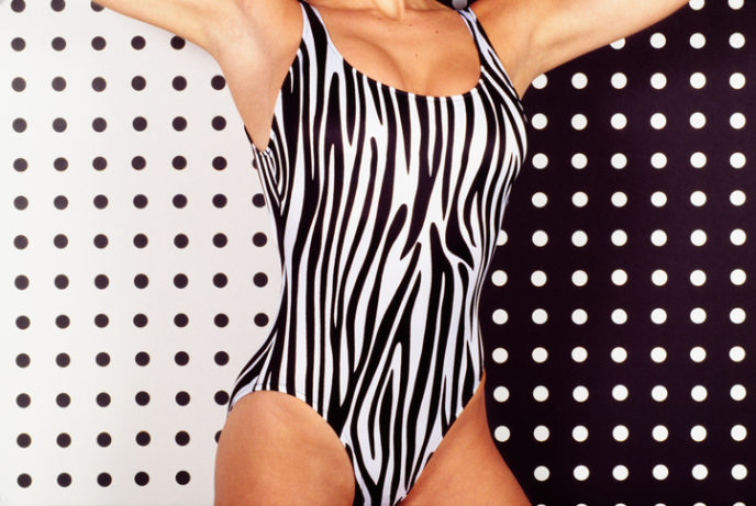 Woman in zebra striped swimsuit