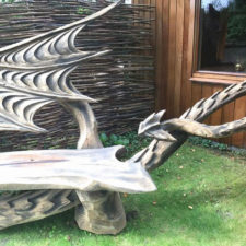 Wood chainsaw carve dragon bench igor loskutow 12 59a69ca6ccb53__880.jpg
