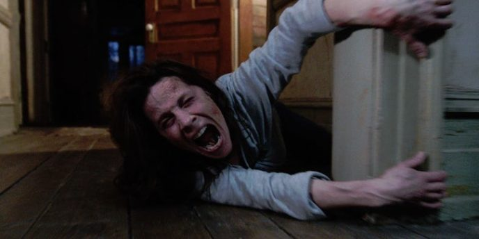 A terrified lili taylor in the conjuring.jpg