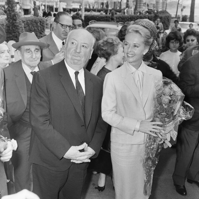 "FILE - In this May 9, 1963 file photo, director Alfred Hitchcock and American actress Tippi Hedren arrive at the Carlton Hotel in Cannes, France for the presentation of their film ""The Birds"" at the Festival Palace. The New York Post reports Hedren has detailed the sexual harassment she says she suffered from Alfred Hitchcock in a new memoir set for release on Tuesday, Nov. 1, 2016. (AP Photo/Jean Jacques Levy, File)"