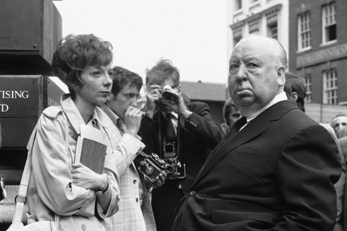 "FILE - In this July 26, 1971 file photo, British film producer and director Alfred Hitchcock, right, discusses filming with actress Anna Massey, one of the stars of ""Frenzy"", in Covent Garden Market, London. Massey, an acting dynasty member whose roles ranged from lonely spinsters to Margaret Thatcher, has died at 73. Massey's agent, Pippa Markham, says she died Saturday, JUly 2, 2011, after a battle with cancer. (AP Photo/Leonard Brown, file)"