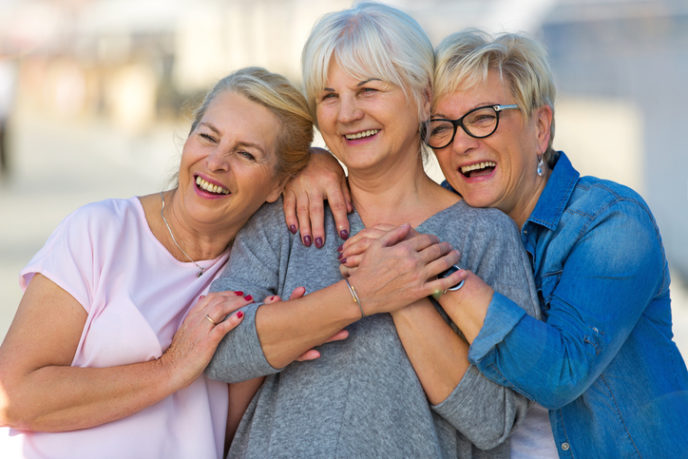 Group of elderly friends posing together