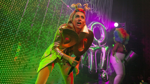 "FILE - In this Thursday, Nov. 19, 2015 file photo, Miley Cyrus performs with Miley Cyrus & Her Dead Petz at the Riviera Theatre in Chicago. The top 10 songs of the year according to Associated Press music editor Mesfin Fekadu, includes Cyrus' ""Pablow the Blowfish."" (Photo by Barry Brecheisen/Invision/AP, File)"
