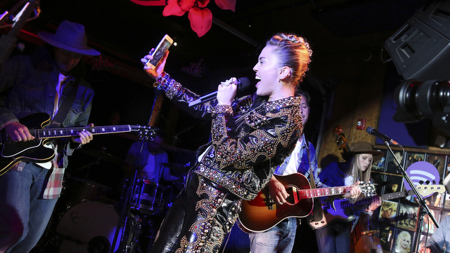 "Miley Cyrus performs at a private concert at Tootsie's to celebrate the release of her album ""Younger Now"" on Friday, Sept. 29, 2017, in Nashville, Tenn. (Photo by Laura Roberts/Invision/AP)"