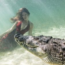 MODELS POSE WITH CROCODILES