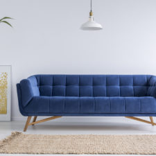 Blue,Sofa,And,Wicker,Carpet,In,White,Simple,Living,Room
