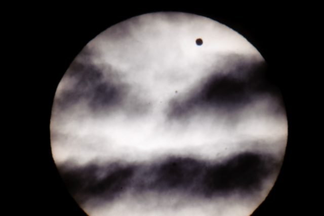 The larger black dot, top right, is the planet Venus as it transits across the face of the Sun as viewed from Earth in Budapest, Hungary, Wednesday, June 6, 2012. (AP Photo/MTI, Peter Komka)