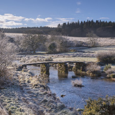 Frosty winter conditions at the old clapper bridge at Postbridge, Dartmoor, Devon, England, United Kingdom, Europe