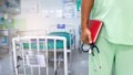 Close up unknown nurse holding stethoscope in hospital