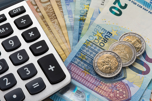 Close up of a calculator and euro money in a financial analyzing concept
