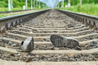 Accident on railway. Rubber boots lying on the railroad