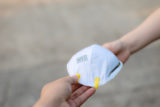 Hand give to / grant / assign / deliver N95 mask or respirator for protect PM 2.5 to other