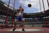 Marcel Lomnicky, of Slovakia, competes in qualifications for the men's hammer throw at the 2020 Summer Olympics, Monday, Aug. 2, 2021, in Tokyo.