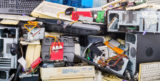 Electronic waste heap from used discarded computer parts and cases. Refuse sorting and disposal Obsolete PC hardware components such as printers, chassis, keyboards and mice. Environmental contamination problem. E waste separation and recycling