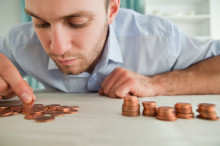 Businessman counting coins