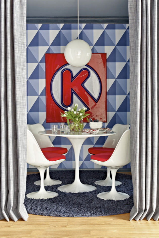 This publicity photo provided by Brian Patrick Flynn shows a tiny breakfast nook designed by Brian Patrick Flynn for his Hollywood Hills weekend home. Flynn used a modern, nautical Cole & Sons wallpaper with a casual feel, then added accents of red through Saarinen tulip chairs and a vintage Circle K sign found at the Rose Bowl Flea Market. Like the best flea market finds, the Circle K sign connects with the homeowner's past (in this case, teen years growing up near Florida beaches), giving his weekend home a personal, nostalgic feel. (AP Photo/Brian Patrick Flynn, Daniel Collopy)