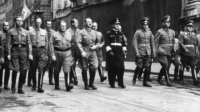 FILE - This Nov. 9, 1938 file photo shows German leader Adolf Hitler, center, with Hermann Goering, center left, and other Nazi commanders marching through Munich. In Munich, Hitler launched his political career with speeches condemning Jews and proclaiming the ethnic superiority of Germans. (AP Photo, File)