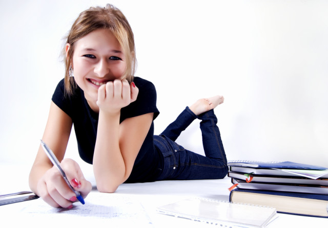 young happy female student studying diligently