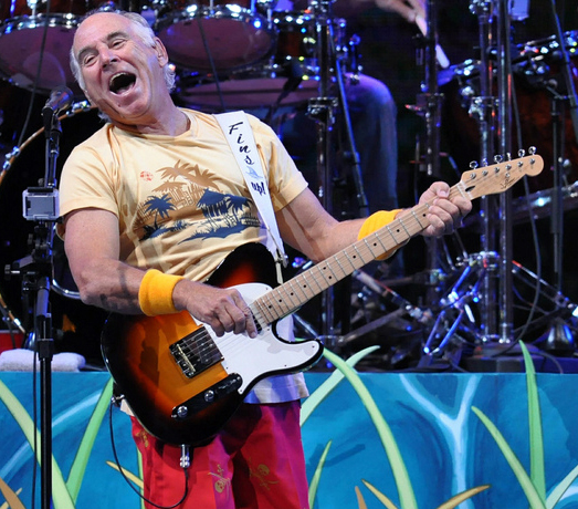 In this Saturday, July 28, 2012 photo, Jimmy Buffett performs in his first-ever concert in the city of Detroit. (AP Photo/Detroit News, Adam Graham)